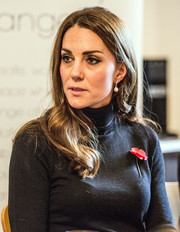 Kate Middleton stuck to her signature loose waves when she visited the Nelson Trust Women's Centre.