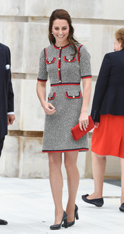 Kate Middleton was classy, as always, in a gray Gucci tweed dress with red and black trim while visiting the Victoria & Albert Museum.