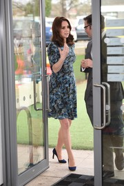 Kate Middleton visited the Reach Academy Feltham wearing a blue floral maternity dress by Seraphine.