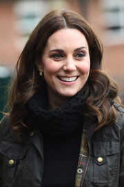 Kate Middleton wore her hair in a tumble of curls during her visit to Robin Hood Primary School.