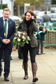 Kate Middleton went rugged in a Barbour utility jacket and a pair of jeans for her visit to Robin Hood Primary School.