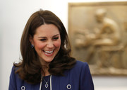 Kate Middleton coordinated her blue and white outfit with a G.Collins & Sons tanzanite and diamond pendant and matching earrings.