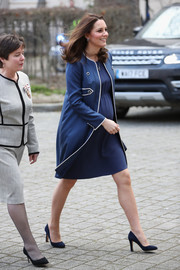 Kate Middleton donned a blue Jenny Packham coat with white trim for her visit to the Royal College of Obstetricians and Gynaecologists.