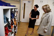 Meghan Markle opted for a simple black maternity dress by Hatch when she visited Smart Works in London.