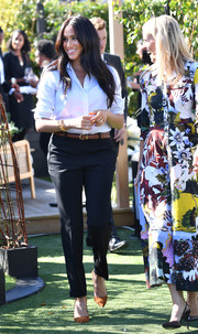 Meghan Markle attended the Smart Set collection launch wearing a classic white button-down shirt from the label.