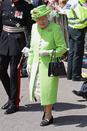 Queen Elizabeth II completed her outfit with a pair of low-heeled loafer pumps.