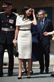 Meghan Markle kept it simple and classy in a white Givenchy midi dress with a layered bodice for her first official engagement with Queen Elizabeth II.