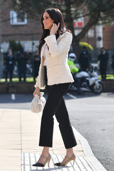 Meghan Markle looked smart in a cream tweed jacket by ME+EM while visiting the Robert Clack Upper School.