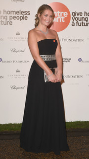Kitty Spencer coordinated her dress with a metallic silver clutch.