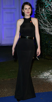 Michelle Dockery cut a svelte figure at the Winter Whites Gala in a body-con black Stella McCartney dress with a racer neckline.