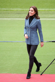 Kate Middleton completed her smart look with black suede ankle boots by Aquatalia For Russell & Bromley.