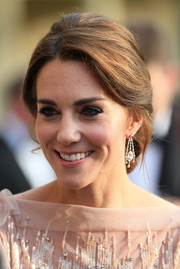 Kate Middleton polished off her look with a pair of diamond chandelier earrings, which were loaned to her by the Queen.