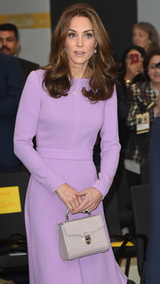 Kate Middleton attended the Global Ministerial Mental Health Summit carrying a stylish taupe crocodile purse by Aspinal of London.