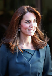 Kate Middleton graced the ICAP Charity Day event wearing this flippy hairstyle.