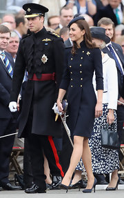 Prince William donned a long wool uniform coat for the Irish Guards Medal Parade.