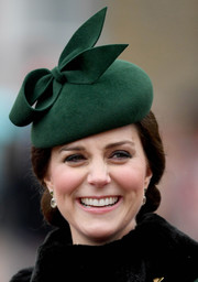 Kate Middleton styled her hair into a classic chignon for the Irish Guards St. Patrick's Day Parade.