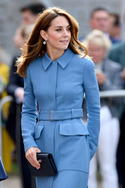 Kate Middleton paired a navy leather clutch by  Asprey London with a belted blue coat for the naming ceremony for the RSS Sir David Attenborough.