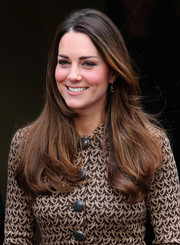 Kate Middleton wore her shiny chestnut locks down with wavy ends when she visited the Only Connect charity.