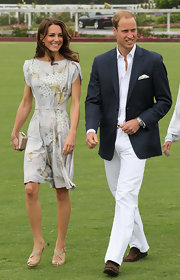 Prince William wore a pair of sleek white slacks with a navy blazer for a benefit polo match.