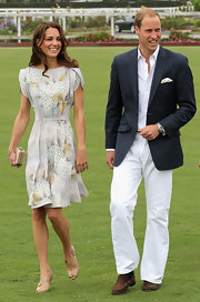 Prince William wore a crisp navy blazer with a white ensemble for his polo benefit.