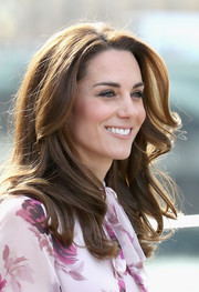 Kate Middleton looked like a walking shampoo ad with her perfect waves while celebrating World Mental Health Day.