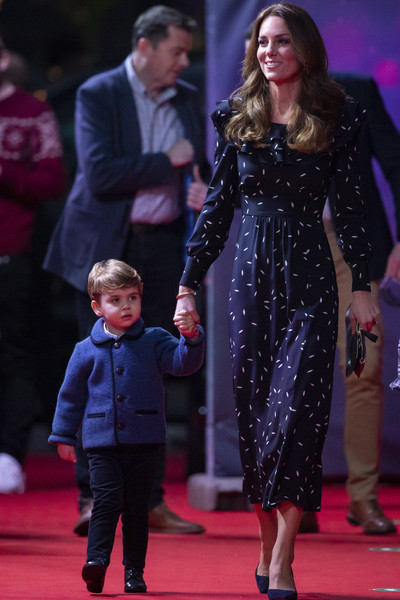 Kate Middleton donned a long-sleeve navy print dress with a ruffle neckline for a special pantomime performance.