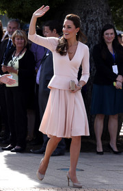 Kate Middleton completed her outfit with a matching flared knee-length skirt.