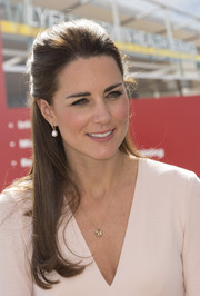 Kate Middleton finished off her look with classic pearl drop earrings.