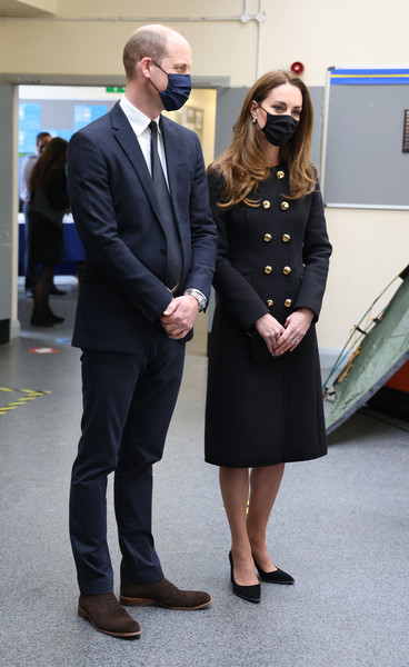 Kate Middleton looked classy in a black Dolce & Gabbana coat with gold buttons while visiting the 282 East Ham Squadron, Air Training Corps.