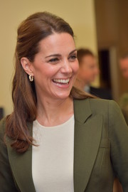 Kate Middleton kept it ladylike with this half-up style during her official visit to RAF Akrotiri.
