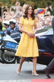 Kate Middleton was a spot of sunshine in an embroidered yellow midi dress by Jenny Packham while visiting the German Cancer Research Center.