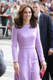 Kate Middleton paired a red Anya Hindmarch frame clutch with a lavender frock for her visit to the Maritime Museum in Hamburg, Germany.