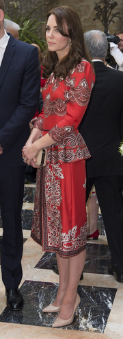 Kate Middleton was demure and stylish in a red paisley-print peplum top by Alexander McQueen while touring Mumbai, India.