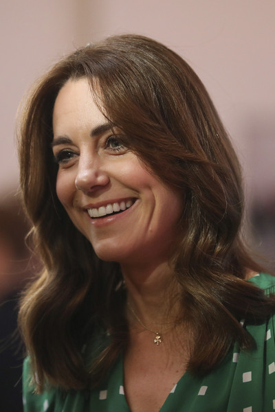 Kate Middleton wore her hair just past her shoulders in a center-parted wavy style at a meeting with Galway Community Circus performers.