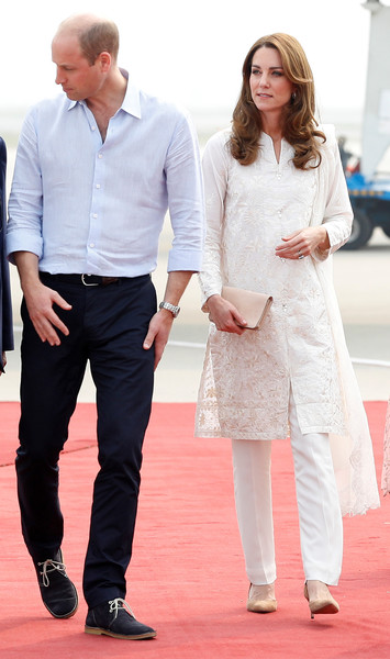 Kate Middleton touched down in Lahore, Pakistan wearing a floral-embroidered white tunic by Gul Ahmed.