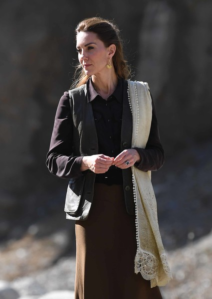 Kate Middleton accessorized with an embroidered scarf while visiting the village of Bumburet in Pakistan.