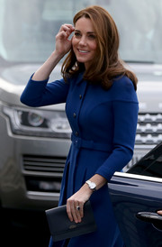 Kate Middleton paired a navy leather clutch by Smythson with a matching coat dress for her visit to McLaren Automotive Composites Technology Centre.