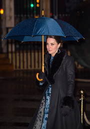 Kate Middleton completed her cold-weather accessories with a pair of black faux-fur cuffs, also by Troy London.