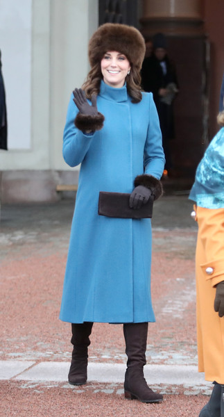 Kate Middleton bundled up in a blue funnel-neck coat by Catherine Walker for her visit to the Princess Ingrid Alexandra Sculpture Park in Norway.