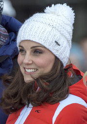 Kate Middleton kept warm in cute style with a white pompom beanie by Barts while touring Norway.