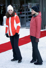 Kate Middleton teamed her jacket with a pair of black snow pants.