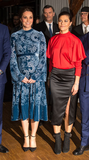 Princess Victoria paired her top with a high-slit satin pencil skirt, also by Stylein.