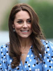 Kate Middleton visited Steward's Academy wearing a loose hairstyle with curly ends.