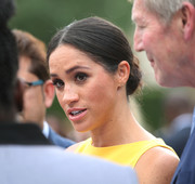 Meghan Markle attended the Your Commonwealth Youth Challenge reception wearing her hair in a classic bun.