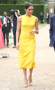 Meghan Maxwell chose a simple yellow midi dress by Brandon Maxwell for the Your Commonwealth Youth Challenge reception.