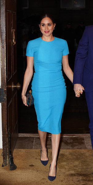Meghan Markle headed to the Endeavour Fund Awards wearing a simple turquoise sheath dress by Victoria Beckham.