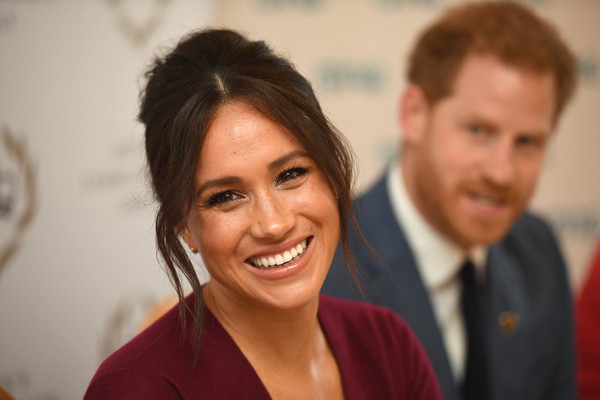 Meghan Markle looked retro-chic with her beehive while attending a roundtable discussion on gender equality.