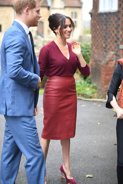 Meghan Markle completed her monochromatic ensemble with a pair of burgundy suede pumps by Sarah Flint.