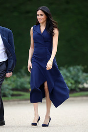 Meghan Markle looked breezy in a sleeveless navy midi dress by Dion Lee while attending a reception in Melbourne, Australia.