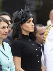 Meghan Markle wore a fancy black fascinator by Philip Treacy at the official opening of ANZAC Memorial in Australia.
